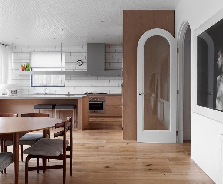 modern interiors design love the arched door in this