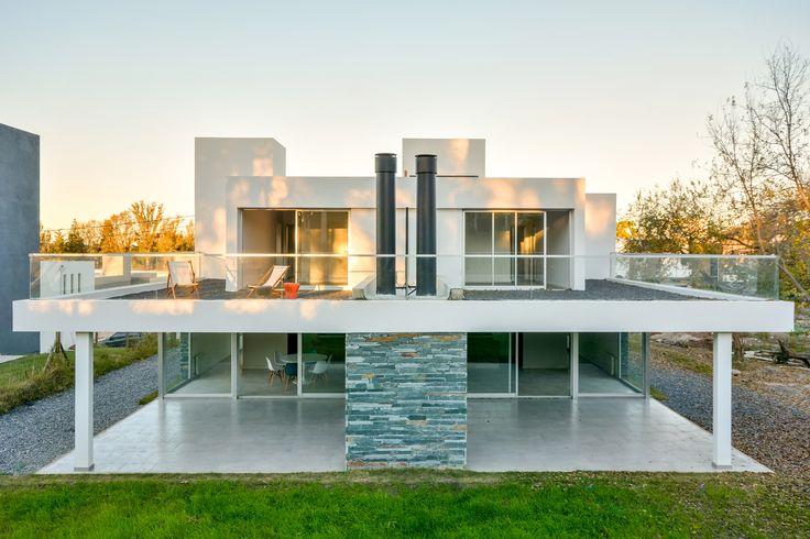 Modern house design paired residences estudio a 3 for Modern house description